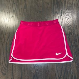 Hot pink Nike golf skirt with white stripes